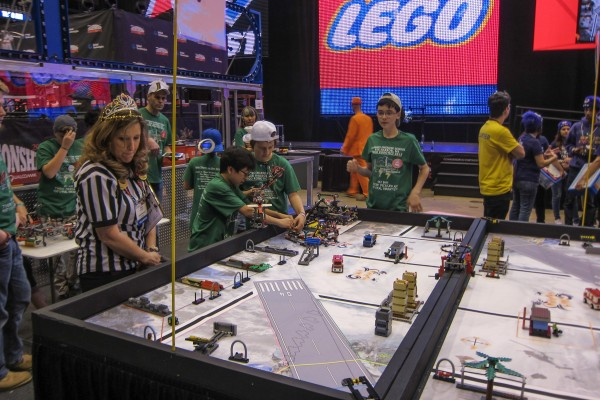 Wearing green T-shirts, pupils from Conners Emerson School in Bar Harbor compete at the First Lego League World Festival robotics competition in St. Louis on April 27. The team brought home two awards, one for First Place in strategy and innovation and a Third Place in robot performance.
