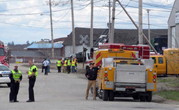 A mix of firefighters, EMTs and police work during a disaster drill on Depot Street in Lincoln on Saturday.