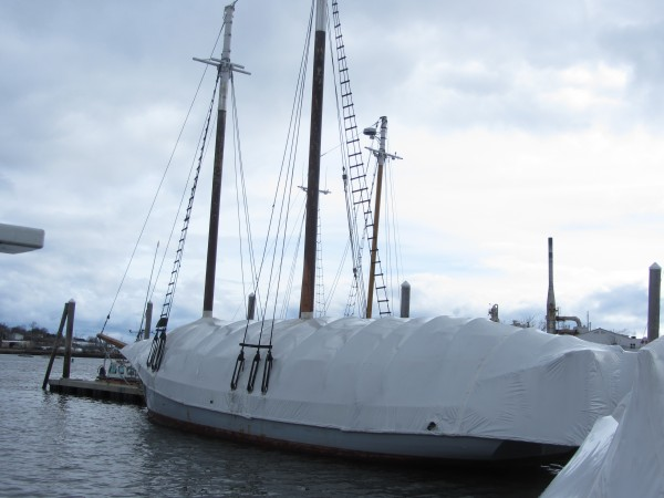 The schooner Timberwind is wrapped in plastic on Monday at Lermond's Cove in Rockland.