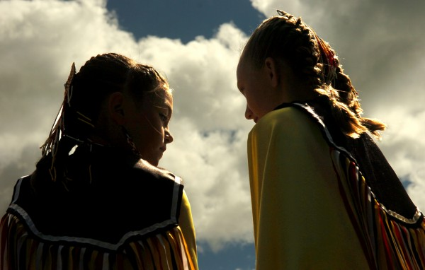 Andrea Kilbirde (left) and Kelsey McDonald, of the Micmac tribe of Prince Edward Island, wait for their turn to dance during the opening ceremonies of the seventh annual North Country Inter-Tribal Pow-Wow, in this 2007 file photo.