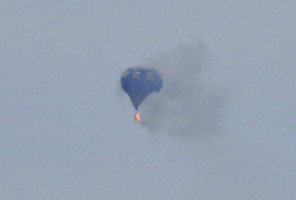 Two people are dead and one is missing after a hot air balloon hit a power line and caught fire during a festival  north of Richmond, Virginia, May 9, 2014.