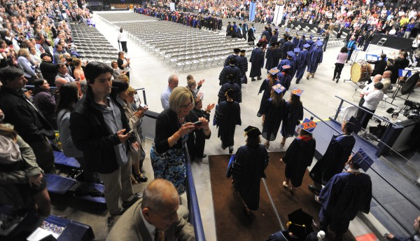 Students walk into Alfond Arena for the 112th commencement ceremony Saturday at the University of Maine in Orono.