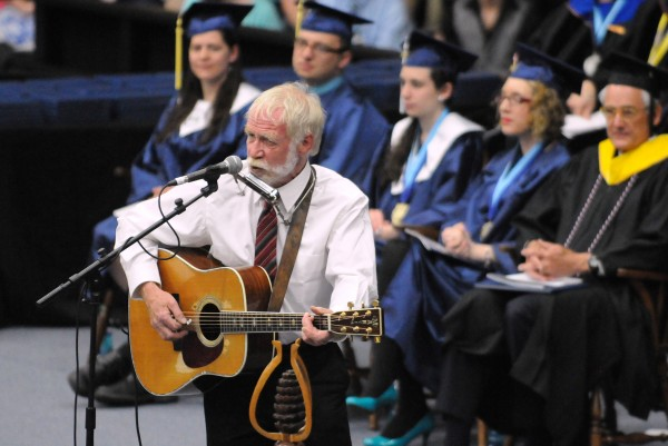 Singer and songwriter Dave Mallett performs during the 112th commencement ceremony Saturday at the University of Maine in Orono.