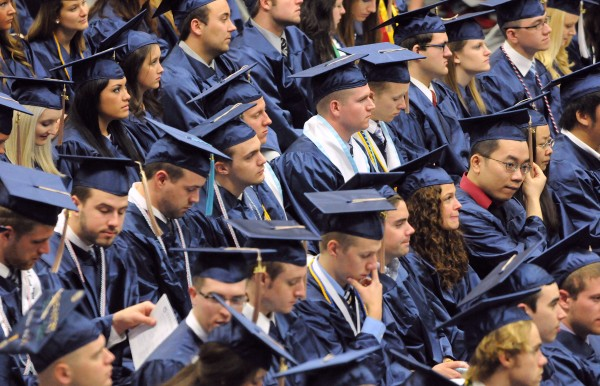 Members of the Class of 2014 listen during the 112th commencement ceremony at the University of Maine in Orono on Saturday.