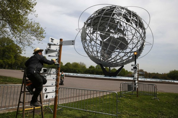 An artist works on a piece marking the 50th anniversary of the 1964 World's Fair at Flushing Meadows-Corona Park in the Queens borough of New York on May 12, 2014. The 1964 World's Fair in New York drew 51 million visitors to gaze in awe at its Technicolor visions of the future, sample exotic cuisines and join in singing along at the wildly popular &quotIt's a Small World&quot attraction. Fifty years later, New York City will celebrate the fair's remarkable impact with the hope of recapturing some of its wonder and promise in an anniversary festival.