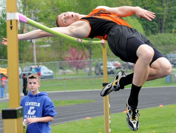 Brewer's Nick Turner clears the high jump bar at 5 feet, 10 inches, that earned him a victory in the event and helped his team win Saturday's River City Rivals track meet in Lewiston.