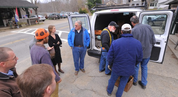 Customers eager to look through new merchandise wait for Skip Brack (3rd from right)  to open up his van on Saturday morning in Liberty.  Brack, the owner of Liberty Tool Co., said he intends to sell two of his three stores.