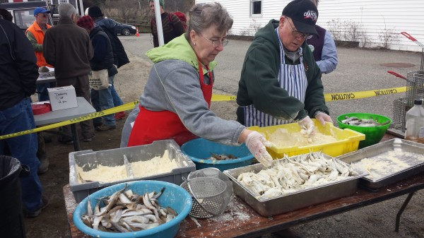 Volunteers prepare smelts for deep frying at the Downeast Salmon Federation's annual smelt fry in Columbia Falls in April.