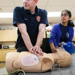 EMT volunteers Nate Fitzgerald and Prathusha Yerramilli train on a CPR dummy Wednesday, May 14, at the Falmouth Fire Department, where increases in call volume spurred a $50,000 budget increase to pay salaries for daytime shifts for part-time emergency medical technicians.