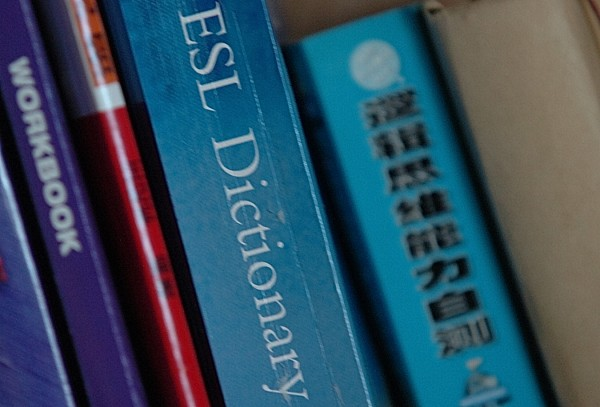 An English as a second language dictionary and a Chinese text about logic are seen in a John Bapst dorm room.