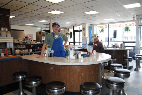 Owner Dennis Fogg stands behind the counter at Uncle Andy's Diner in South Portland. The Food Network reality show, &quotRestaurant: Impossible,&quot will film an episode at the Ocean Street business next month.