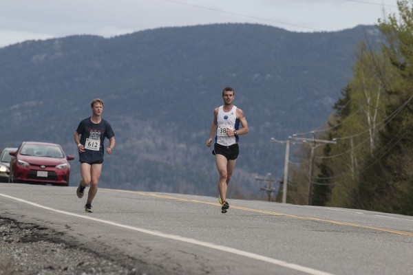 Steven McCarthy (right) of Greene and Connor Wagner of Orrington run side by side in Sunday's Sugarloaf Marathon. McCarthy went on to win the race with a time of 2 hours, 47 minutes, 10 seconds.