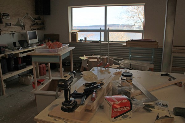 Woodworker and designer Tom Weis keeps a workshop on the lower floor of The Steel House and lives in space on the top floor of the building with views looking across Rockland Harbor.