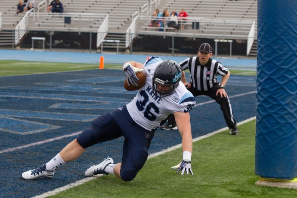 University of Maine sophomore Jeremy Salmon scores a touchdown in the annual Jeff Cole Scrimmage on Saturday morning at Morse Field in Orono.