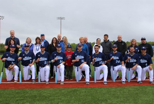 The eight senior members of the University of Maine baseball team pose with their parents, siblings and coaches prior to Sunday's America East game against Maryland Baltimore County in Orono. It was the final home contest for the seniors.