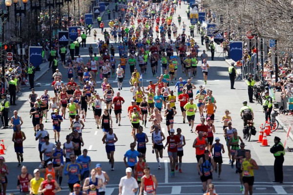 Runners stream down Boylston Street towards the finish line during the 2014 Boston Marathon.