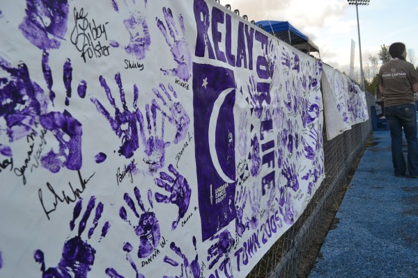 This sign at Relay for Life of Penobscot County on Friday night bears the handprints of cancer survivors. The event raised more than $100,000 for the American Cancer Society under the motto &quotCelebrate. Remember. Fight Back.&quot