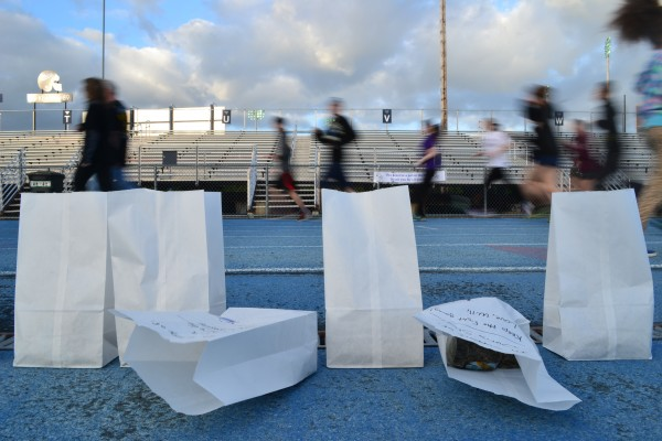 Paper bags line UMaine's Morse Field in memory of those who lost their fight with cancer and in support of survivors and those still battling cancer. At nightfall, candles were lit in each bag as Relay for Life of Penobscot County participants walk the track in silence to reflect on their loved one's battle with cancer.