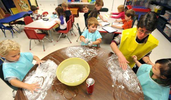 Children draw in shaving cream in a pre-kindergarten class at the Center Drive School in Orrington in 2011.