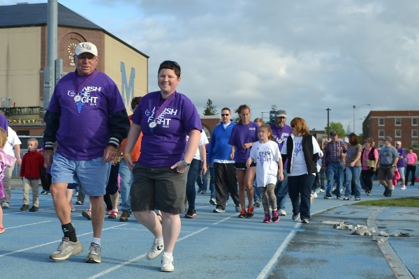 Cancer survivors take the first lap in the Relay for Life of Penobscot County during the event's 21st year Friday at the University of Maine track at Morse Field. Relay participants cheered on the cancer survivors as they completed their lap at Morse Field. More than 600 people participated in the event, which continued through Saturday.
