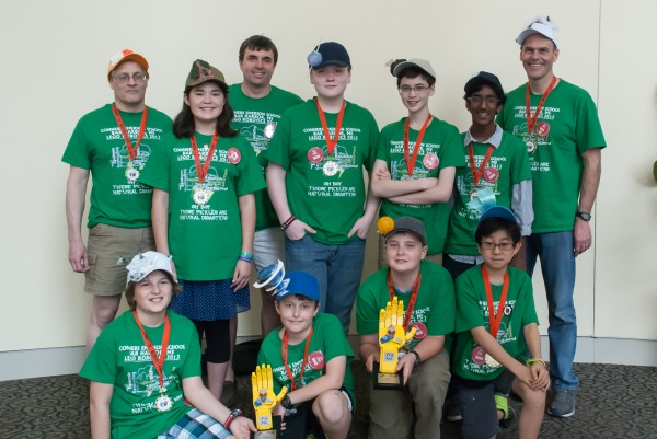A team of middle schoolers from Connners Emerson school in Bar Harbor recently brought home two prizes, including a First Place award, from an international Lego robotics competition in St. Louis, Missouri. Pictured at the competition from left to right in the front row are Thomas Korstanje, Nate Ingebritson, Lucas Ingebritson and Takanao Ishimura. In the back row are coach James Kadin, Anna Naggert, coach Wythe Ingebritson, Branden Dagenais, Robbie Denegre, Yash Nair, and coach Dave Gallup.