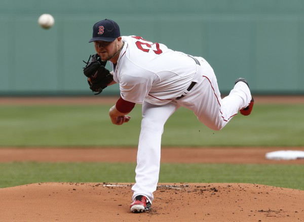 Boston Red Sox starting pitcher Jon Lester (31) pitches against the Oakland Athletics during the first inning at Fenway Park in Boston Saturday.