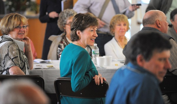 Sen. Susan Collins (center) listens as Sen. Angus King speaks during a Town Hall meeting on Friday at the Margaret Chase Smith Library in Skowhegan.
