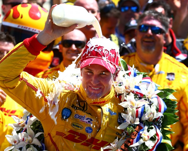 IndyCar Series driver Ryan Hunter-Reay dumps milk on his head as he celebrates after winning the 2014 Indianapolis 500 at Indianapolis Motor Speedway Sunday .