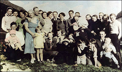 Marie Elmire Touchette of St. Georges, Quebec (blue dress on left) pictured next to her husband, John Philbrick, and their family in Rangeley, Maine in the 1930s.