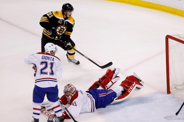 Boston Bruins right wing Loui Eriksson (21) scores a goal against Montreal Canadiens goalie Carey Price (31) during the third period of game five of the second round of the 2014 Stanley Cup Playoffs at TD Banknorth Garden in Boston Saturday night.