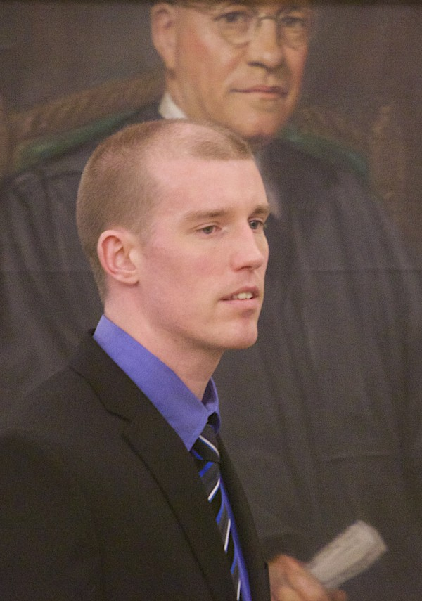 Nicholas Sexton, 33, of Warwick, Rhode Island, shown on May 1, is being accused of the murder of three people and setting their car containing the bodies on fire in August 2012.