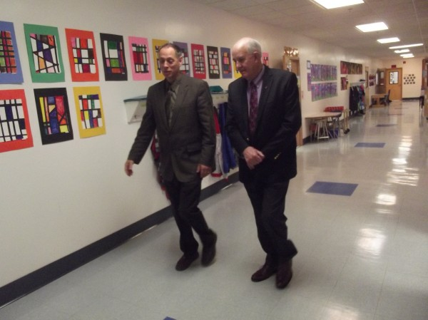 Machias Superintendent Scott Porter (left) accompanies state Education Commissioner Jim Rier (right) on a tour of Rose Gaffney Elementary School. Rier visited to present the 2014 school report card - an 'A.'