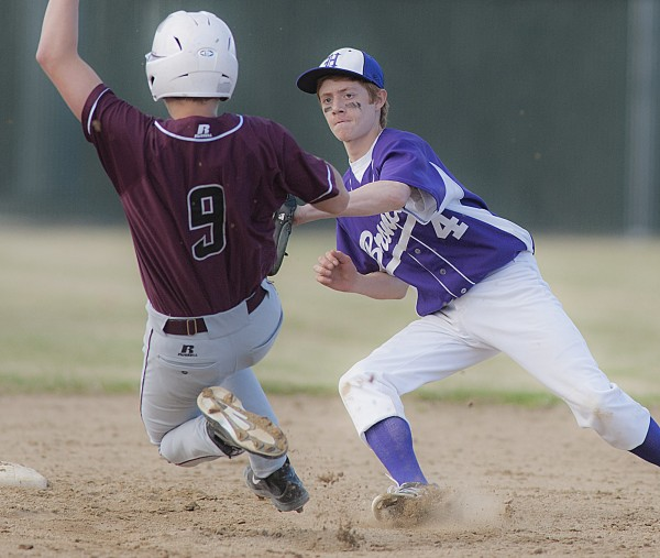 Hampden infielder Ben Huston (right) puts the tag on Edward Little's Drew Lashua in the fifth inning of Saturday's high school baseball game against Edward Little at Bordick Park in Hampden.