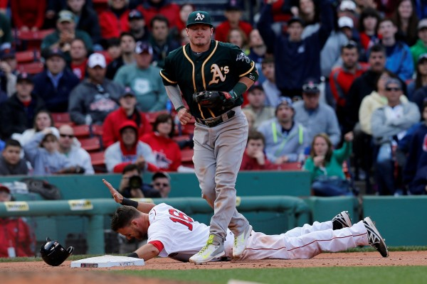 Boston's Will Middlebrooks (16) reacts to being tagged out by Oakland Athletics third baseman Josh Donaldson (20) on a fielders choice during the 10th inning at Fenway Park in Boston Sunday.  The Athletics won 3-2.