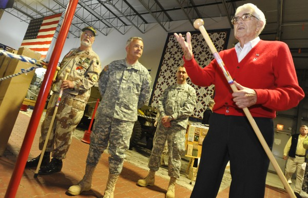 During a special ceremony at the Cole Land Transportation Museum in Bangor, museum founder and World War II veteran Galen Cole (right) thanks the approximately 50 combat veterans who traveled to the museum to receive maple walking sticks with markings to indicate their service in 2010.