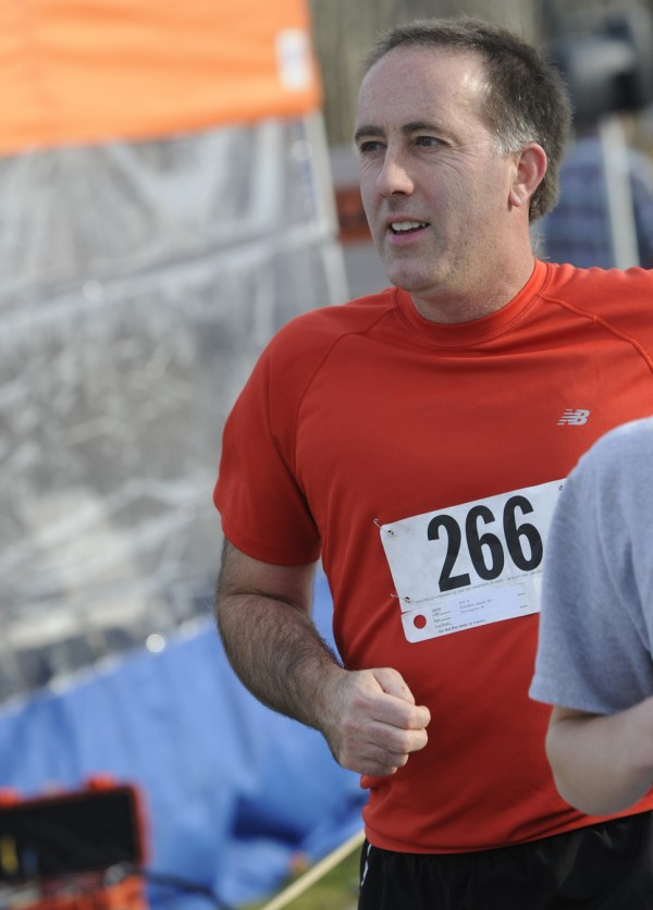 In this November 2011 file photo, Glendon Rand crosses the finish line of the 30th annual Turkey Trot three-mile road race in Brewer.