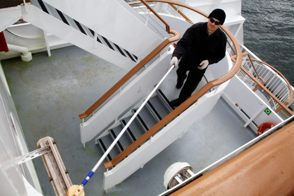 A workman swabs the exterior of the Nova Star cruise ship in Portland on Friday. The ship will be christened in Boston on Monday.