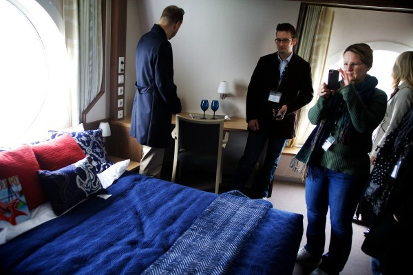 Staffers from U.S. Rep. Chellie Pingree's office get a look at a state room aboard the Nova Star cruise ship in Portland on Friday.