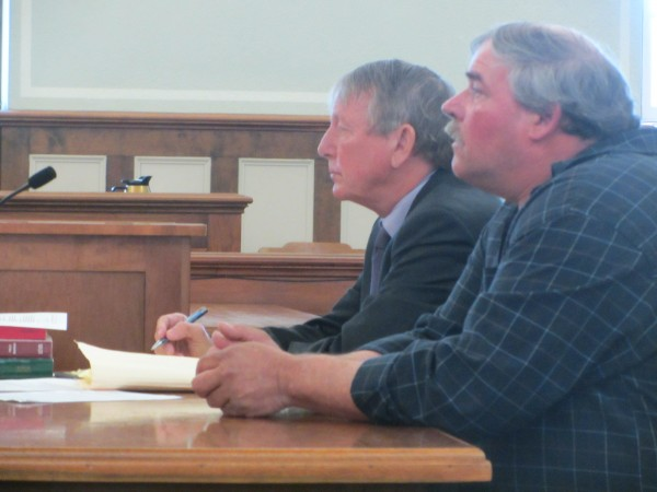Gary Jones and his attorney Steven Peterson await the start of Jones' trial Tuesday in Knox County Superior Court.