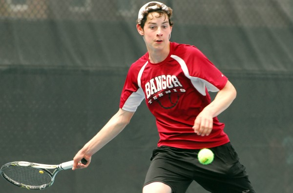 Sam Bolduc of Bangor High School keeps a sharp eye on the ball during a match at the 2014 MPA Tennis Singles Championship at Colby College in Waterville on Saturday.