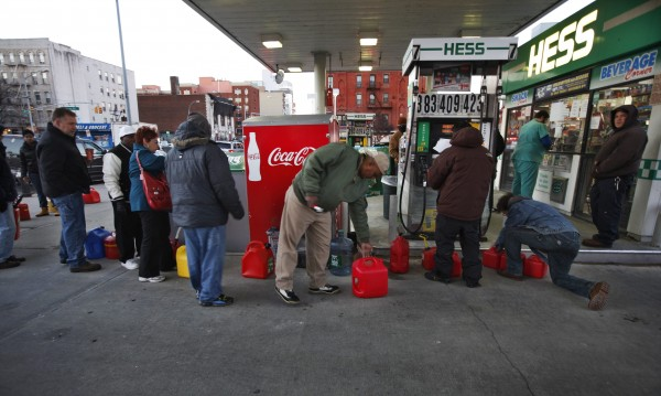In this November 2012 file photo, customers wait in line for fuel at a Hess gas station in Brooklyn, New York. Hurricane Sandy left a trail of destruction and despair in the Northeast, but it also exposed a surprising fault line in the ability of gasoline stations to keep fuel flowing.