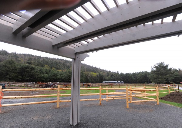 Wildwood Stables in Acadia National Park is debuting a new shelter for visitors and fence around the area where horse carriages depart.