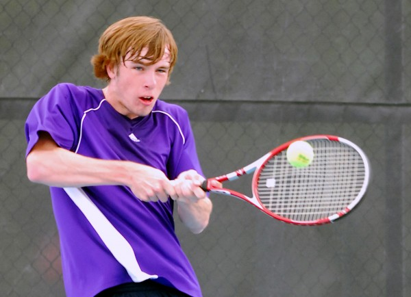 Hampden Academy's Oakley Kilgour delivers a backhand during the 2014 MPA Tennis Singles Championship at Colby College in Waterville on Saturday.