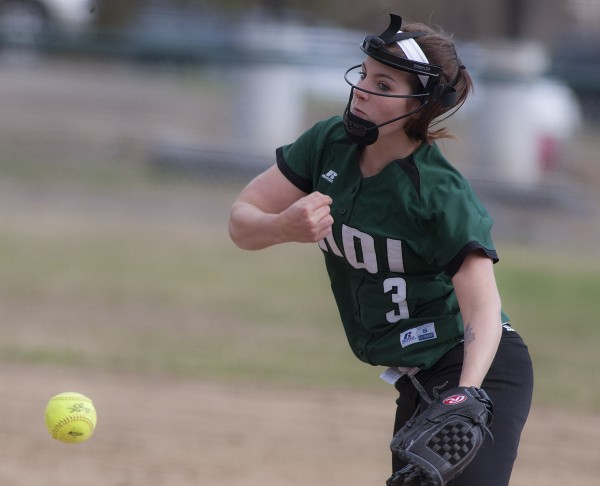Mount Desert Island's Haley Littlefield delivers a pitch against Old Town during a game on Monday.  Facemasks for pitchers and infielders are becoming more prevalent in high school softball.