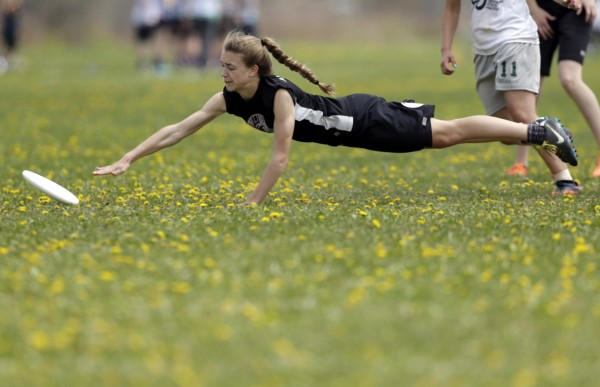 An Amherst player lays out but can't get reach a pass during an Ultimate game against Fryeburg Academy on Saturday in South Portland.
