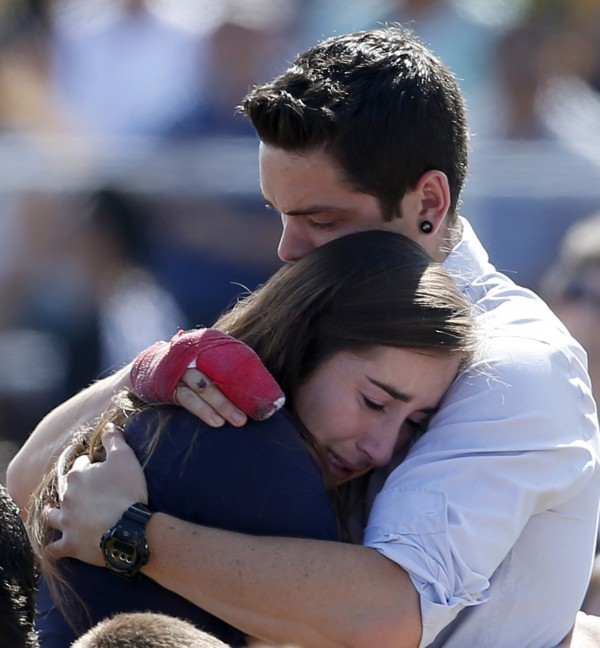 Students console one another at the University of California Santa Barbara's Harder Stadium during a memorial service in honor of the victims of Friday's Isla Vista rampage in Santa Barbara, California, May 27, 2014.