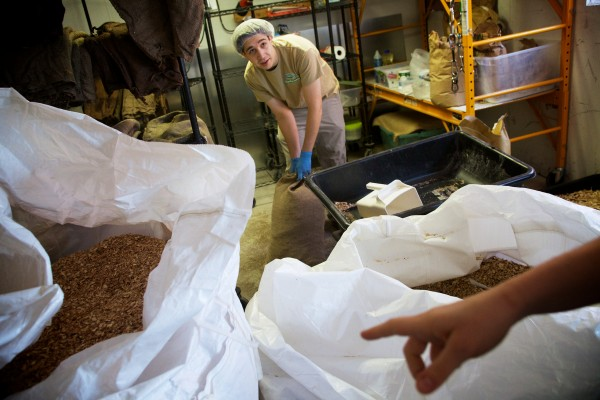 Jordan Adams chips and bags custom blends of wood, such as oak, maple and poplar, at Mousam Valley's mushroom-growing operation in Springvale recently.
