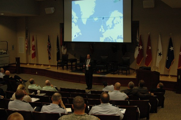 SoliDG President Patrick Arnold discusses the economic benefits of Portland's partnership with Icelandic steamship company Eimskip during a symposium on new Arctic sea routes sponsored by the Maine National Guard and University of Maine.