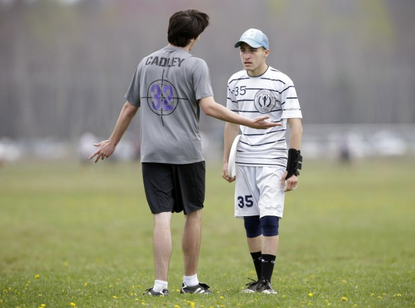 Aidan Cadley (left) of John Jay High School in Cross River, New York, discusses a penalty called on him by Dan Goldstein of Needham High School in Massachusetts.