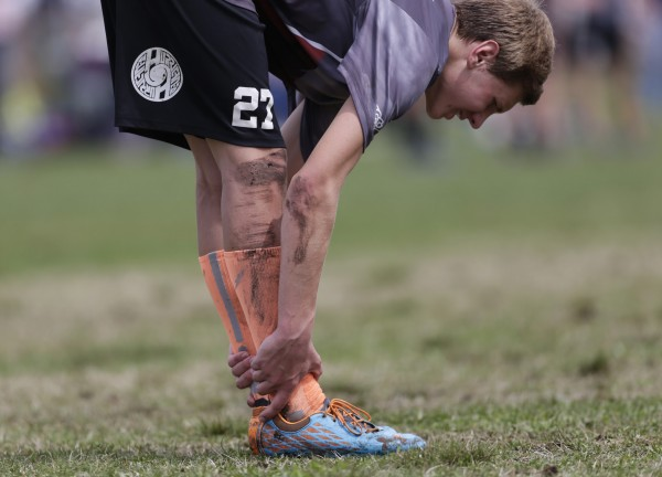 Amherst's Lenny Wright stretches after a score during an Ultimate game on Saturday in South Portland.
